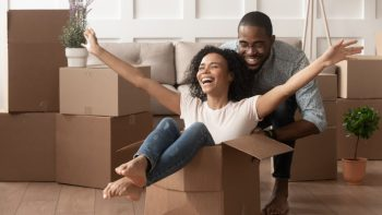 FHB couple happy boxes moving conveying home